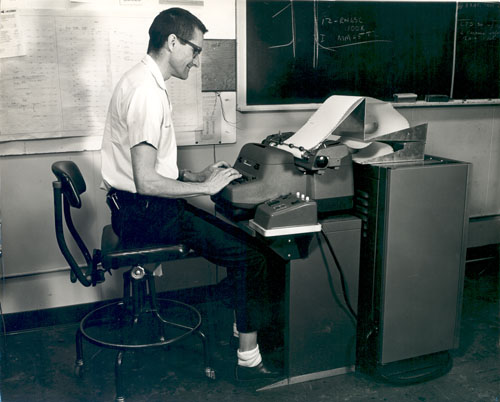Rand employee Nelson G. Lucas at JOSS console