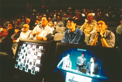 Rapt audience members follow closely at the Deep Blue vs. Kasparov re-match in New York City, New York