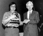 Claude Shannon awards Feng-Hsiung Hsu first prize for Deep Thought at the World Computer Chess Championship in Edmonton, Alberta